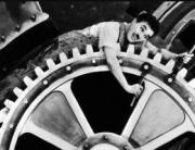 Foto do Charles Chaplin - sobre habitos repetitivos, numa cena de filme em que ele ficava no meio de engrenagens de uma fábrica, realizando tarefas repetitivas, como um robô